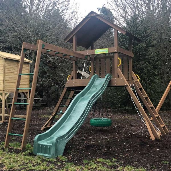 Northbridge tower with Monkey Ladder, 3m (10ft) slide, rock wall with knotted rope, chain climber, 360 degree tyre swivel swing and access ladder with flat treads.