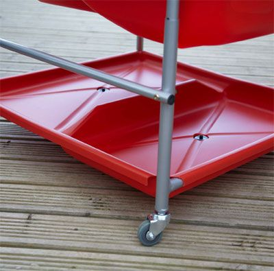The red storage shelf is perfect for storing wet toys that are wanted out of the way.